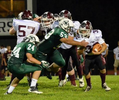 WHS Football Faces Early Challenges
