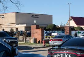 Police set a perimeter at the West Freeway Church of Christ in White Settlement Texas.
