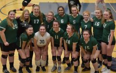 Anna Provoost (top row, third from left) poses with her teammates at a recent match.